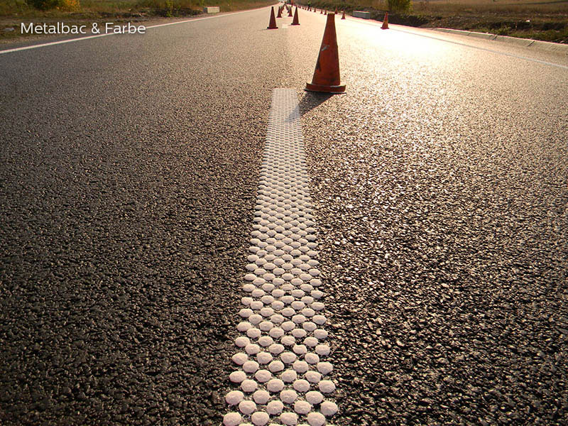 road marking paint; horinzotal road marking signs; road traffic signs; road safety; street signs; cold plastic; bicomponent; 2k paint; agglomerated structured multidot spotflex road marking type 2; parking lot striping paint